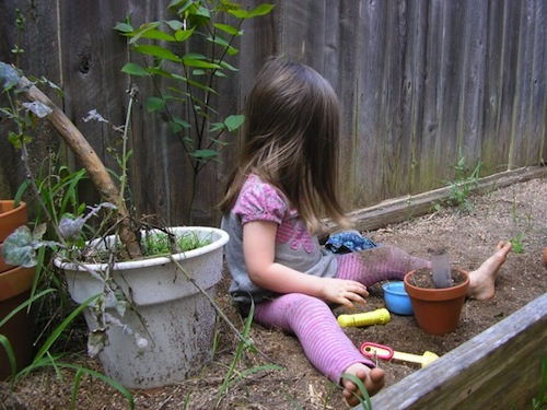 child playing in dirt image