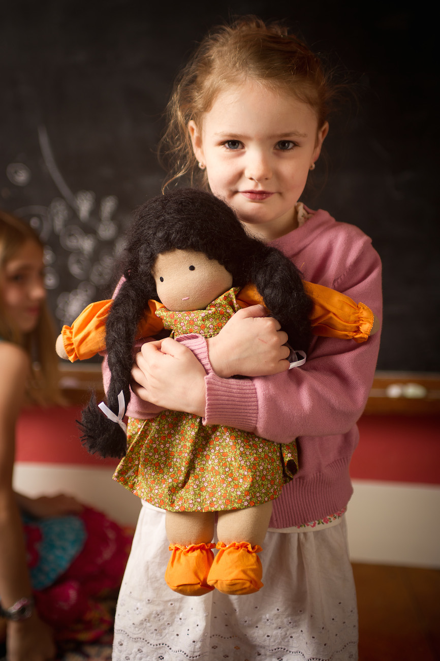 Girl Holding Waldorf Doll