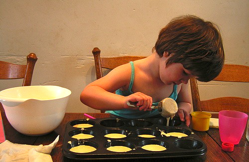 child-making-muffins